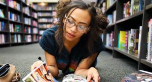young woman reading a comic book