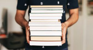 https://www.pexels.com/photo/person-holding-stack-of-books-4218982/