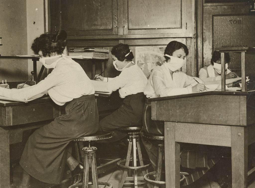 Women clerks in New Your, 1918, wearing face masks. Sourced from the National Archives.