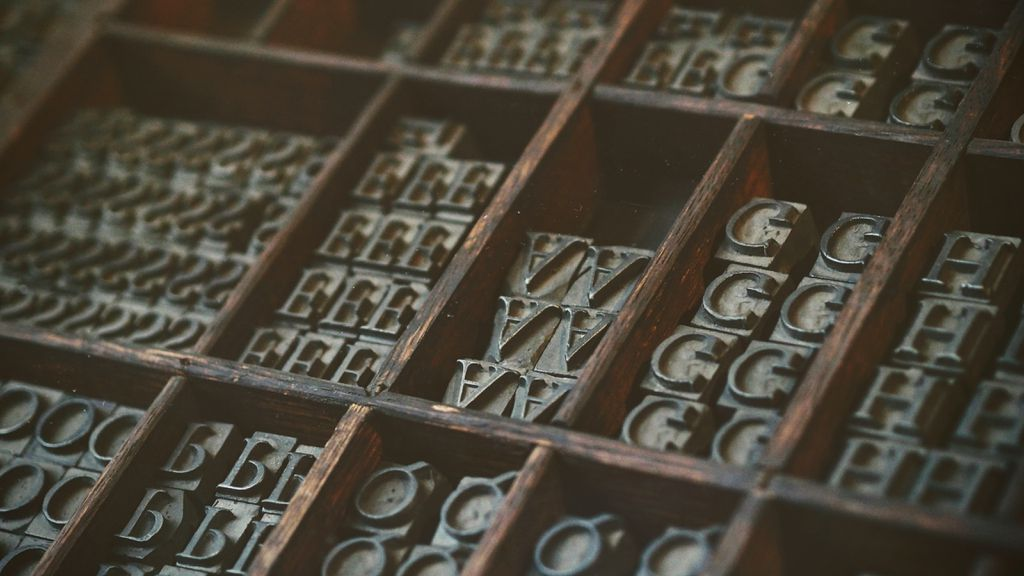 image of assorted letter tiles in a wooden organizer box https://unsplash.com/photos/Oxl_KBNqxGA