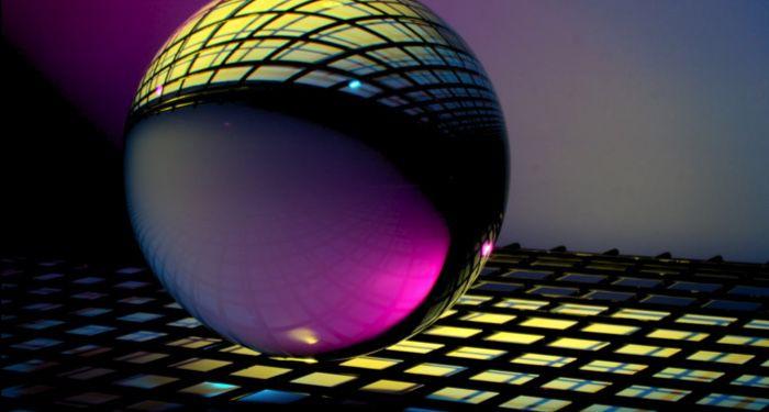 image of glass orb on checkered tile https://unsplash.com/photos/qDG7XKJLKbs