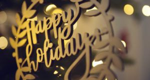 golden metal happy holidays wreath