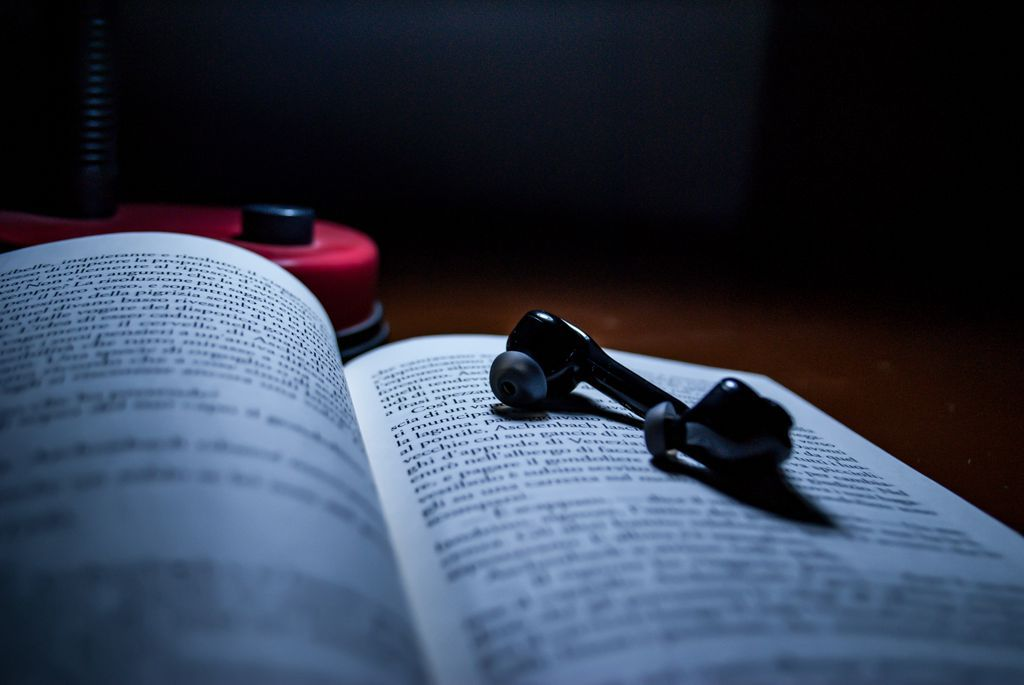 black earpiece on book page