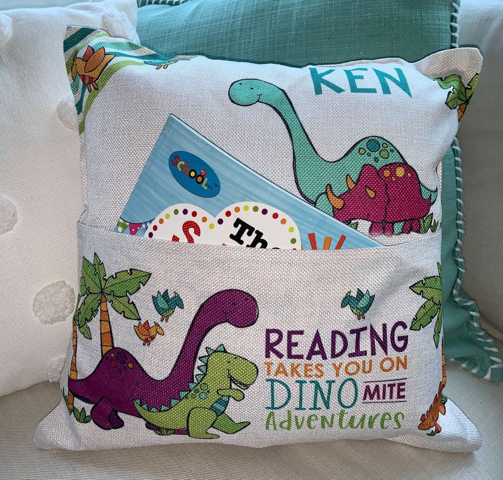 personalized dino book pillow