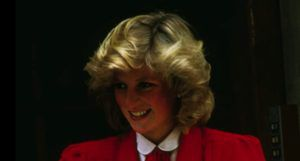 image of Princess Diana in a red suit https://www.imdb.com/name/nm0697740/mediaviewer/rm597604352/