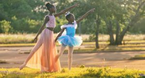 young dancers dancing ballet outdoors