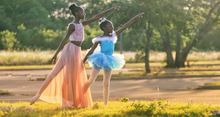 young dancers dancing ballet outdoors