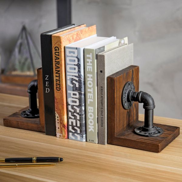 wood bookends with large metal industrial pipes mounted on them