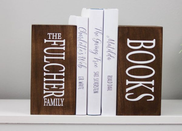 "two wooden bookends with personalized ""Fulcher family books"""