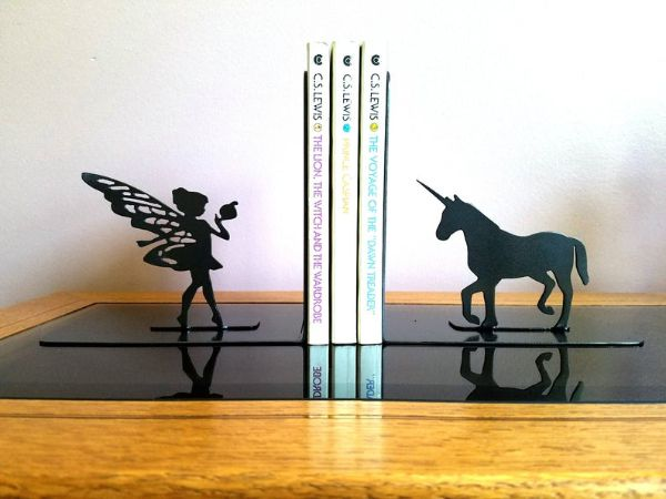 black metal silhouette of a fairy and unicorn on either side