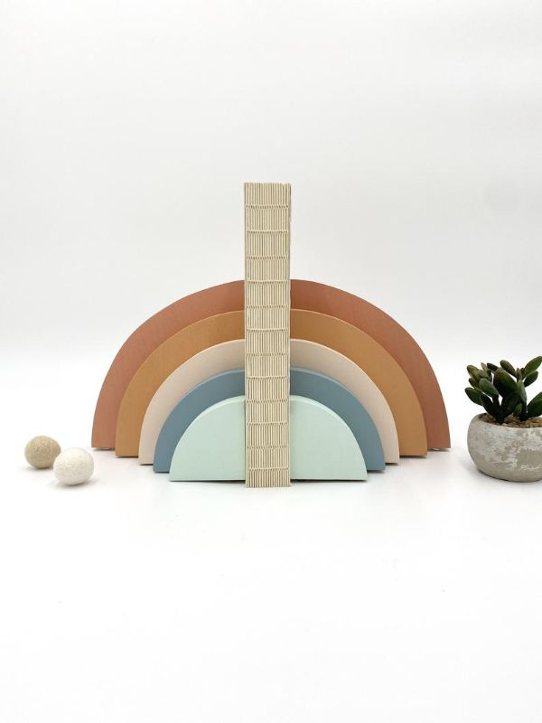 muted color rainbow bookends