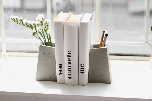 two blockish concrete vases used as bookends