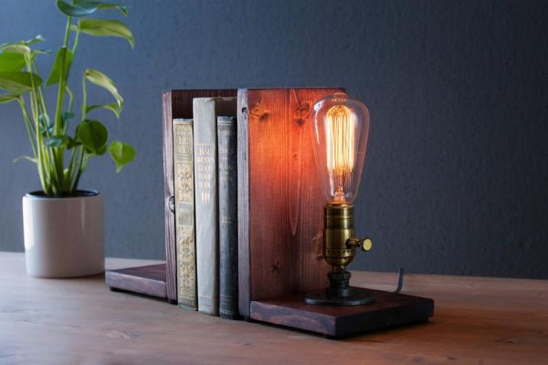 wood ends with an old fashioned light bulb as a lamp on one end