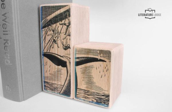 a small and tall wood block with a black and white whale image