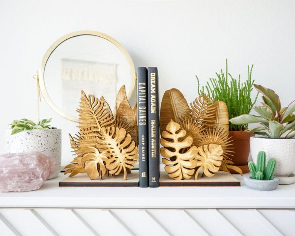 wood etsy bookends with a variety of laser cut plant leaves