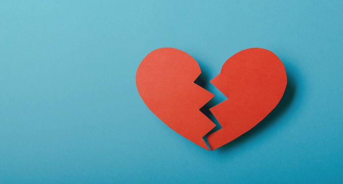 image of a red broken paper heart against a blue background https://www.pexels.com/photo/broken-paper-heart-on-blue-background-5515710/