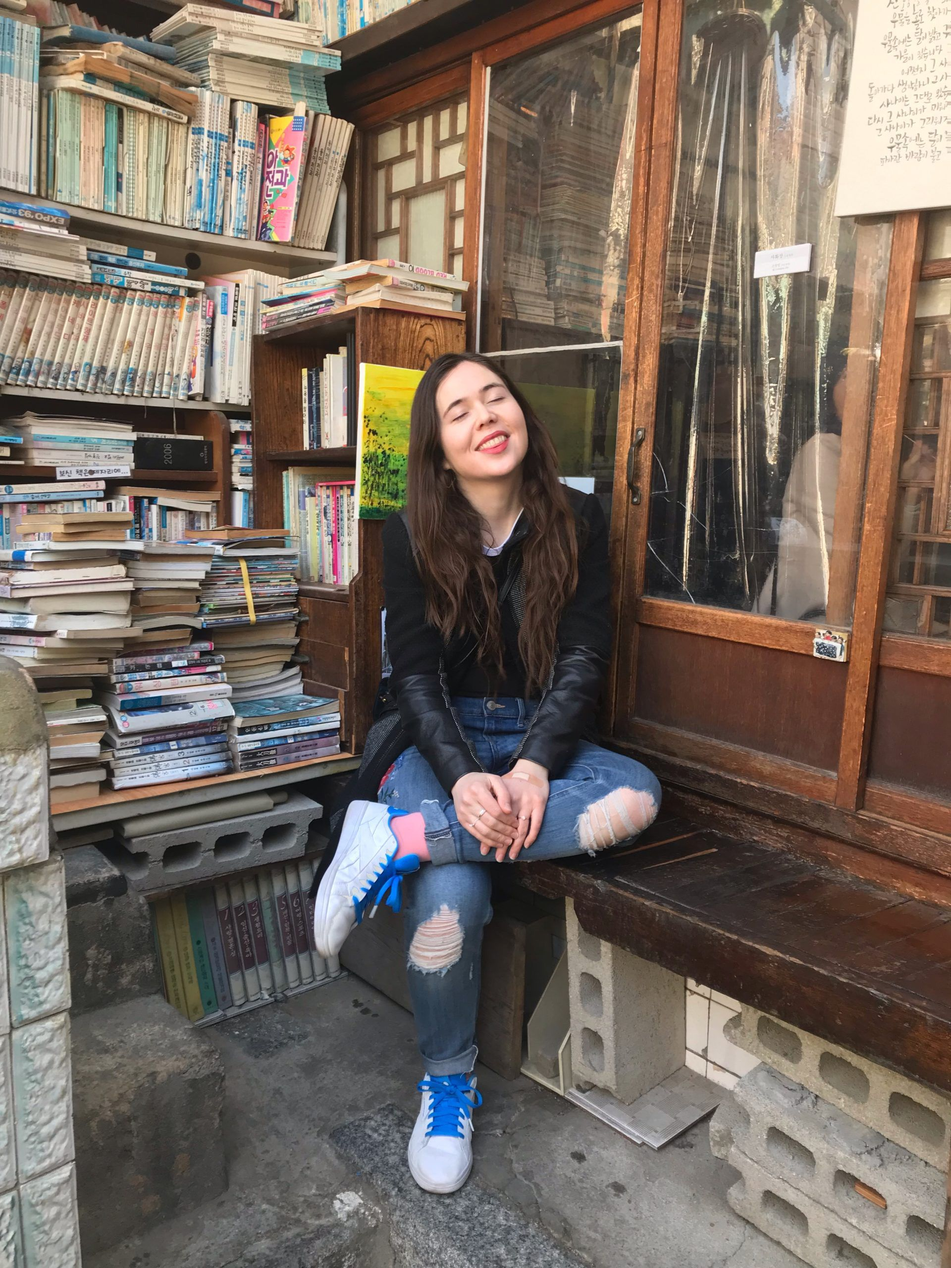 Image of article writer at Daeo bookstore in Seoul. Photo credit: Gianessa Refermat