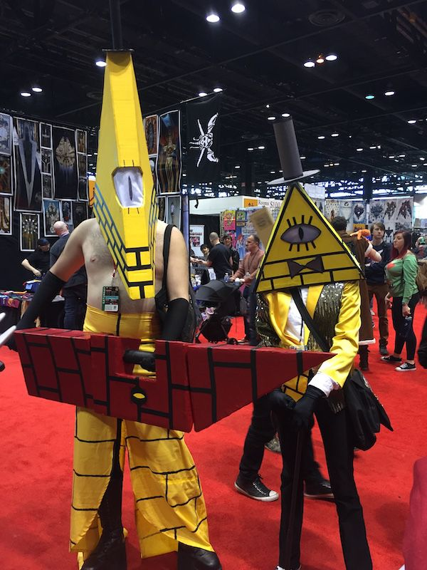 Two Gravity Fall cosplayers with a video game twist. One is Bill and the other is a mashup with Silent Hill's Pyramid Head.