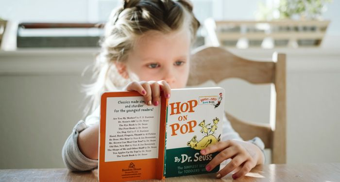 child reading dr seuss book