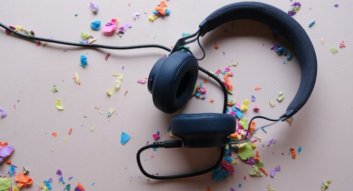 image of headphones on white background with colorful confetti.jpg.optimal