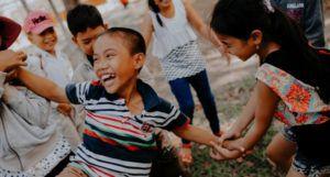image of kids playing on grass https://unsplash.com/photos/0DPyb8t_KfI