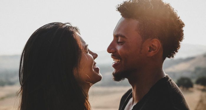 man and woman facing one another and smiling/laughing https://unsplash.com/photos/6rKkr2fh2-I