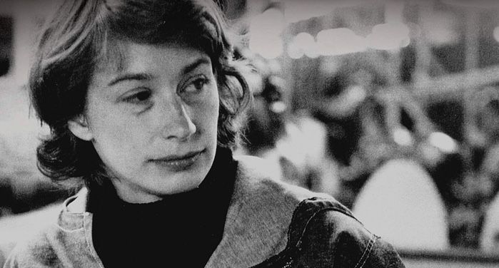 image of Mary Oliver from closeup of book cover of New and Selected Poems