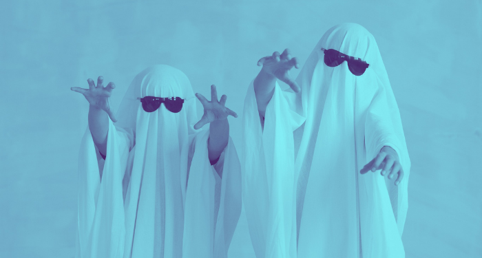 two people dressed as ghosts with white sheets and sunglasses