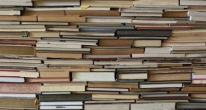 a sea of books stacked tightly together https://unsplash.com/photos/o2fc-C-Uotw
