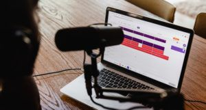 a microphone positioned in front of a laptop computer https://unsplash.com/photos/h6PDEdr9IZo