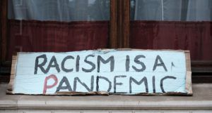 racism is a pandemic sign https://unsplash.com/photos/zswLbyR_b58