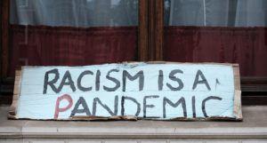 racism is a pandemic sign https://unsplash.com/photos/zswLbyR_b58