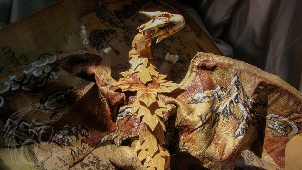 Posable leather dragon painted with elements of the map of Middle-earth