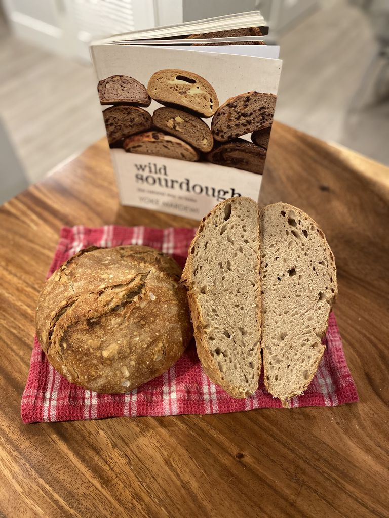 Wild Sourdough cookbook with two baked loaves