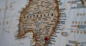 closeup of map showing Australia with a red pin