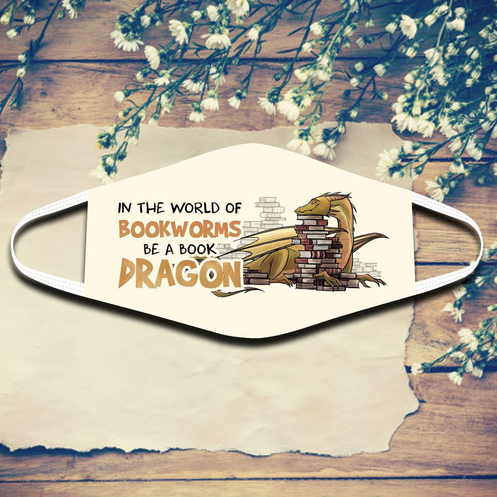 """A face mask with a dragon happily resting its head on a stack of books. The text reads """"In the world of bookworms, be a book dragon"""""""