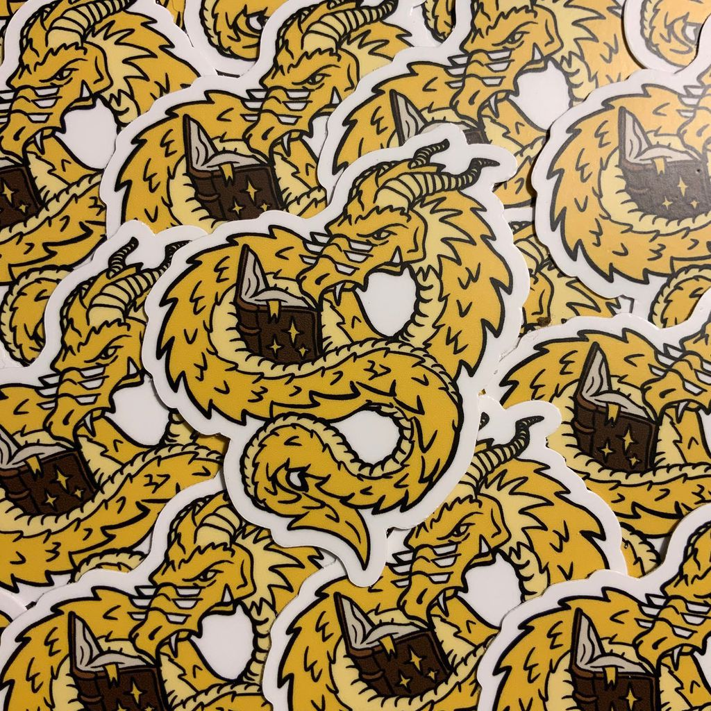 A dragon reading sticker