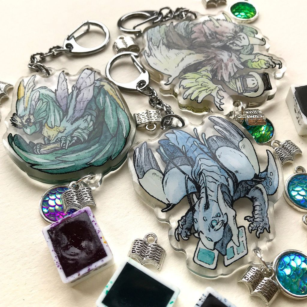 Three acrylic reading dragon charms