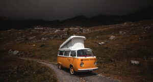orange vw van on a deserted road