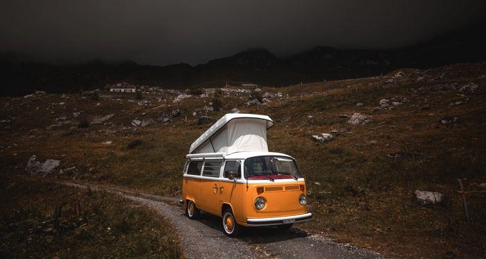 orange vw van on a deserted road