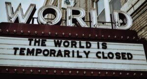 "image of a marquee sign that reads, ""The world is temporarily closed."" https://unsplash.com/photos/Q8m8cLkryeo"