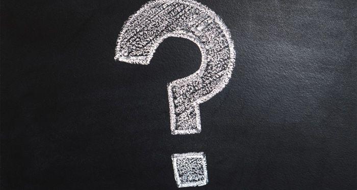 question mark in chalk on chalkboard
