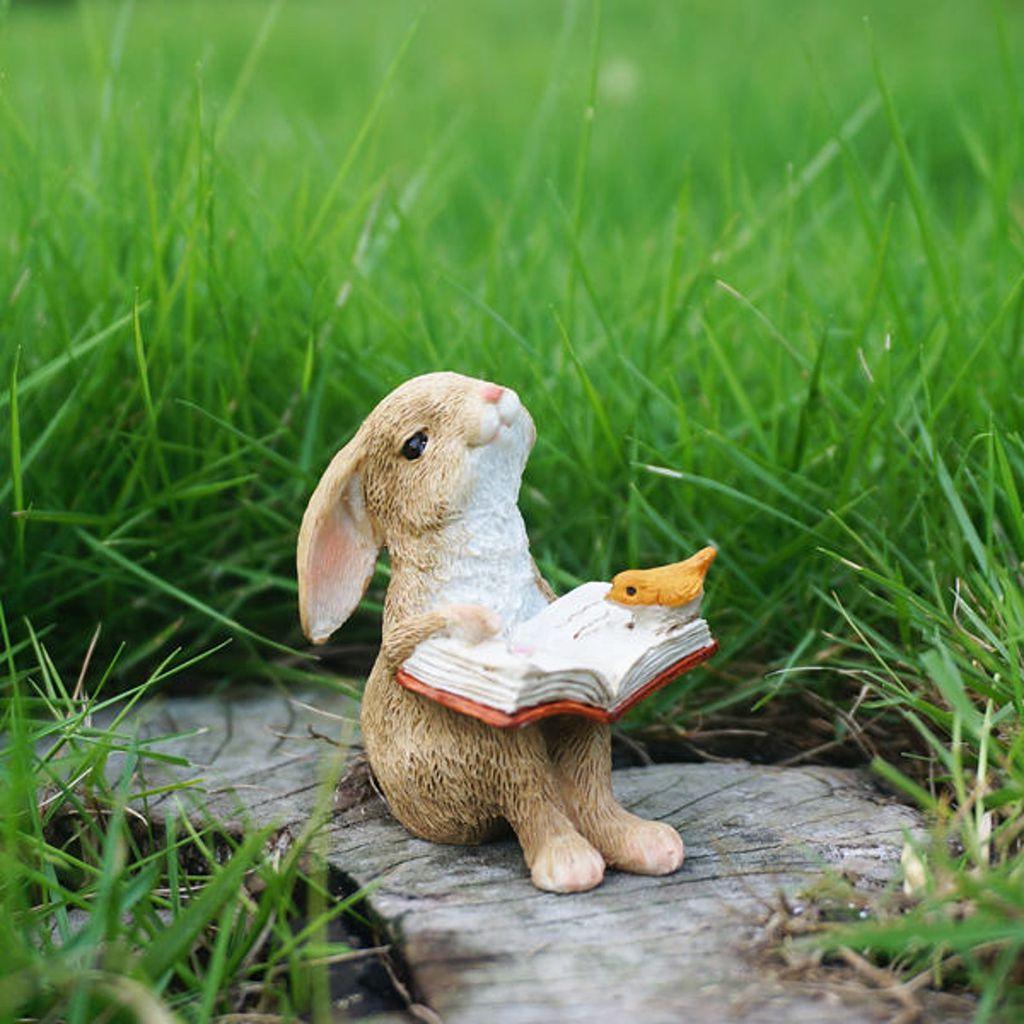 Rabbit reading book figurine
