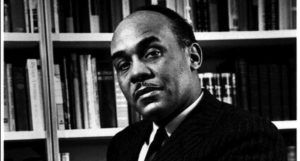 black and white image of Ralph Ellison https://en.wikipedia.org/wiki/Ralph_Ellison#/media/File:Ralph_Ellison_photo_portrait_seated.jpg