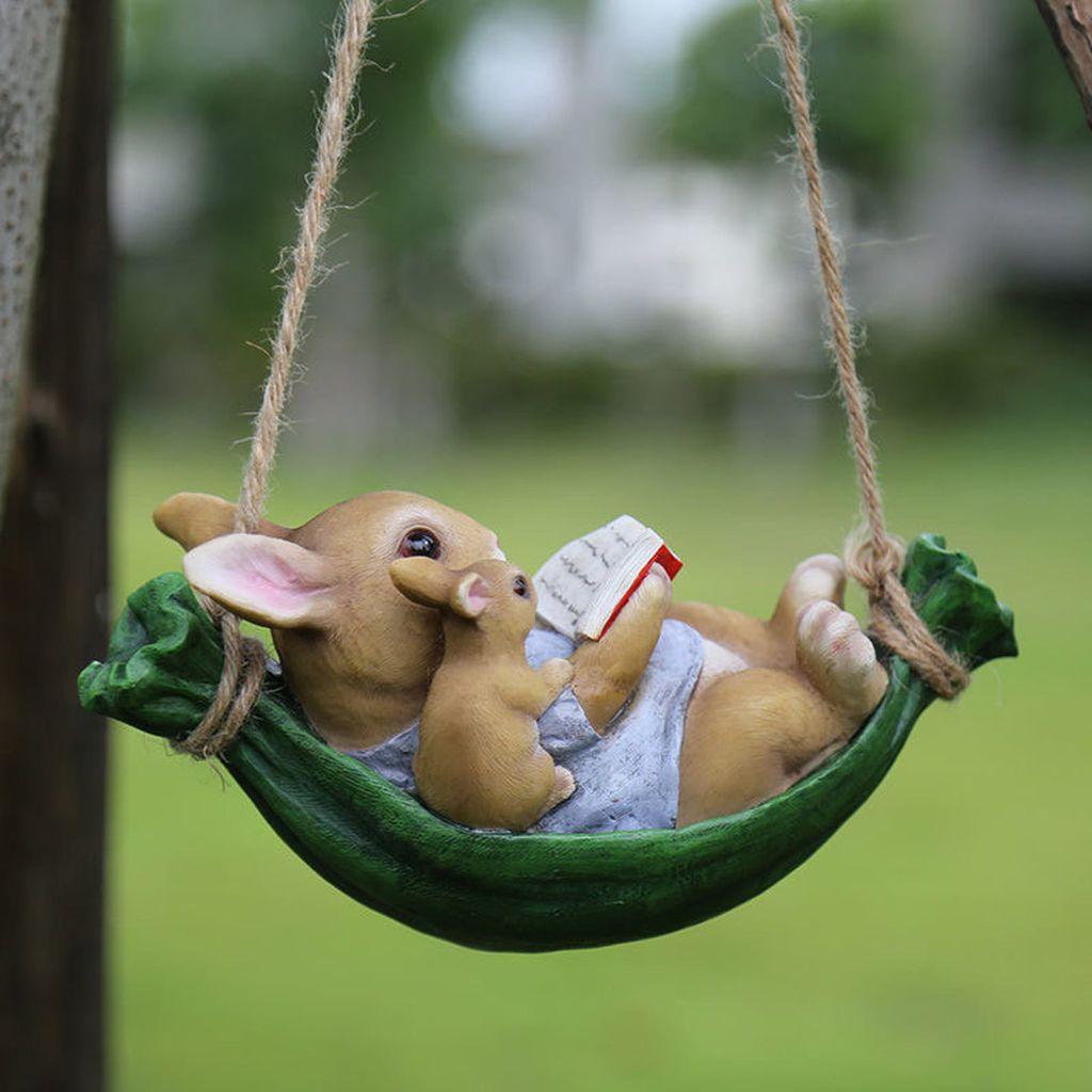 Reading rabbits on swing figurine