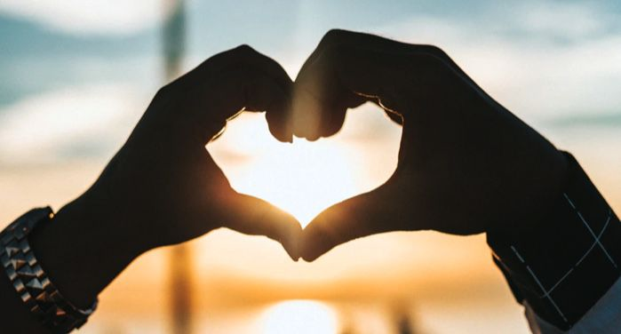 two hands joining to make the shape of a heart with sun setting in the background https://unsplash.com/photos/sitjgGsVIAs