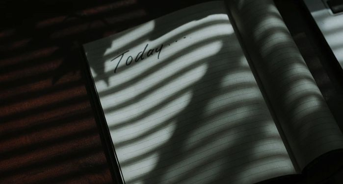 """an open notebook in the shadows of window blinds. The left page of the notebook says """"Today..."""" but is otherwise blank. https://unsplash.com/photos/6tCiSN8LX7w"""