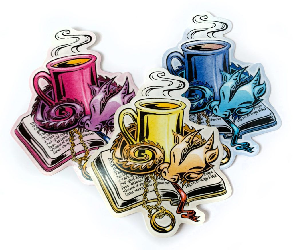 A sticker of a dragon curled up around a coffee cup on an open book