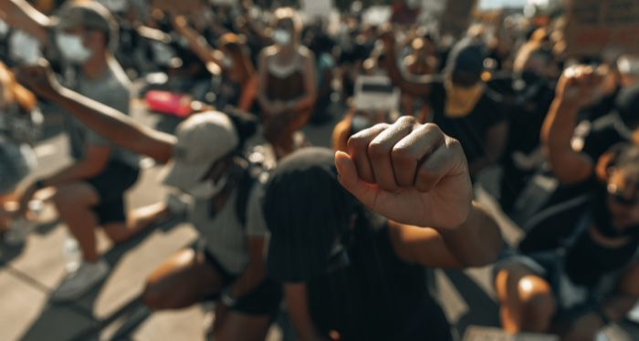 A fist raised in solidarity for George Floyd (IG- @clay.banks)