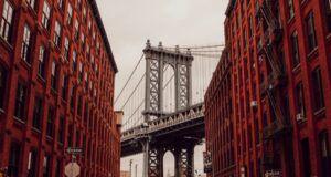 Brooklyn New York view of the bridge between two brownstone buildings